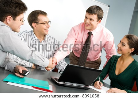 Portrait of confident people shaking hands at business meeting - stock photo