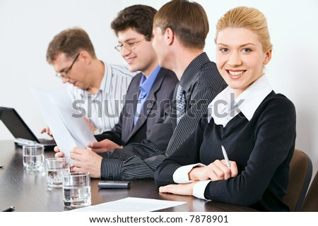 Portrait of confident people sitting at the table at business meeting