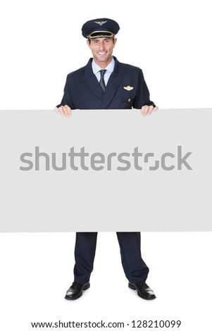 Portrait of confident pilot. Isolated on white - stock photo