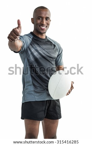 Portrait of confident rugby player smiling and showing thumbs up against white background
