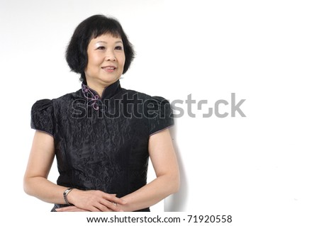 Portrait of confident senior asian woman with arms folded - stock photo