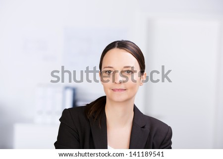 Portrait of confident serious businesswoman in office - stock photo