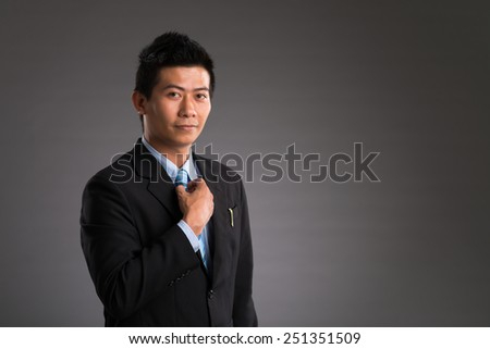 Portrait of confident Vietnamese businessman looking at the camera - stock photo