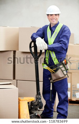 Portrait of confident warehouse worker standing in workplace - stock photo