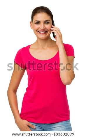 Portrait of confident woman using smart phone while standing over white background. Vertical shot. - stock photo