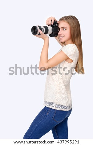 Portrait of confident woman with camera shooting photo
