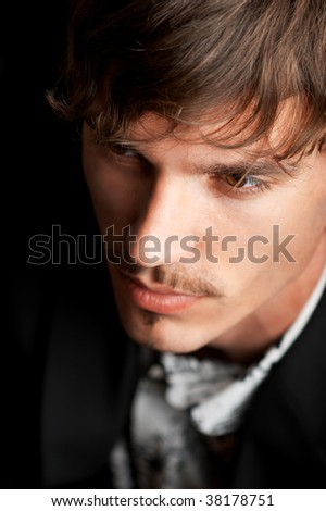 Portrait of confident young adult against black background - stock photo