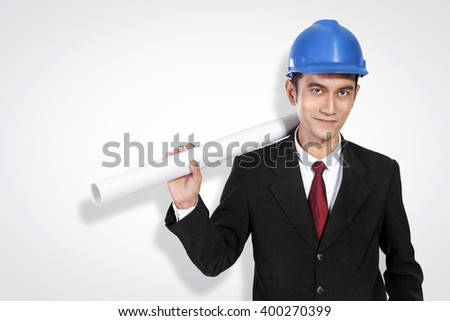 Portrait of confident young Asian architect posing to camera, on white background - stock photo