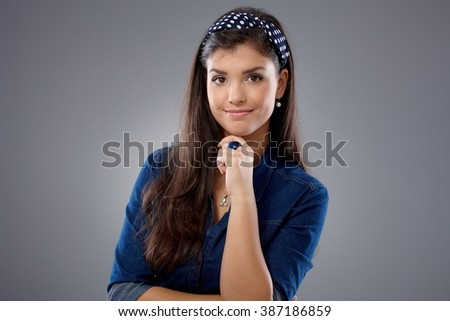 Portrait of confident young attractive woman. - stock photo