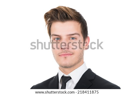 Portrait of confident young businessman isolated over white background - stock photo