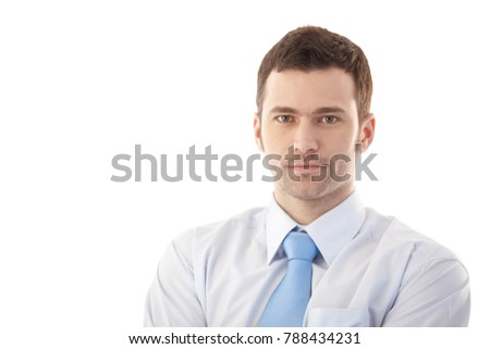 Portrait of confident young businessman over white.