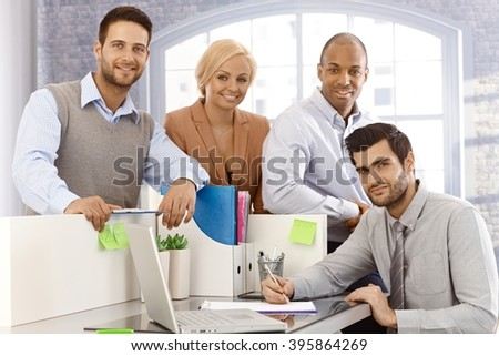 Portrait of confident young businessteam working together. - stock photo