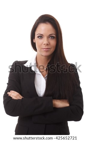 Portrait of confident young businesswoman standing arms crossed, looking at camera. - stock photo