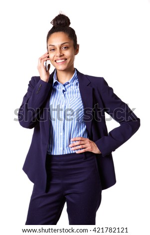 Portrait of confident young businesswoman talking on mobile phone against white background  - stock photo