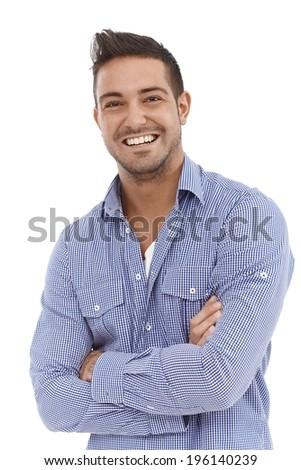 Portrait of confident young man smiling arms crossed. - stock photo