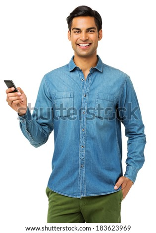 Portrait of confident young man using smart phone over white background. Vertical shot. - stock photo