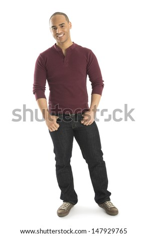 Portrait of confident young man with hands in pockets standing isolated over white background