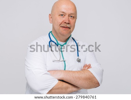 Portrait of confident young medical doctor on white background