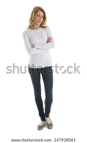 Portrait of confident young woman in casuals standing arms crossed against white background - stock photo