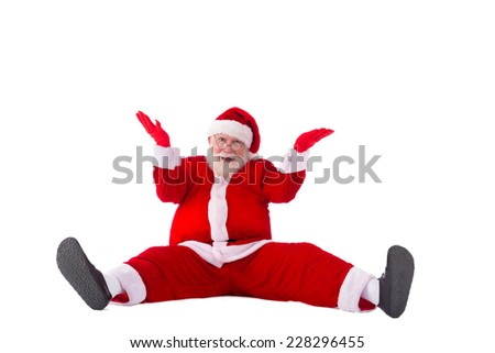 Portrait of confused Santa Claus sitting on the floor - stock photo