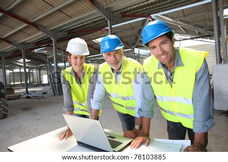Portrait of construction team on site - stock photo