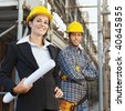 Portrait of construction worker and female architect. - stock photo