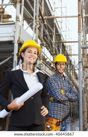 Portrait of construction worker and female architect. Copy space - stock photo