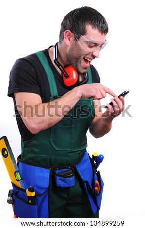 Portrait of construction worker speaking phone