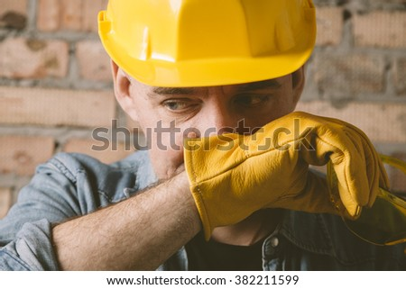 portrait of construction worker with yellow hat - stock photo