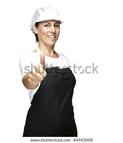 portrait of cook wearing apron and mesh top hat doing okey symbol against white background - stock photo