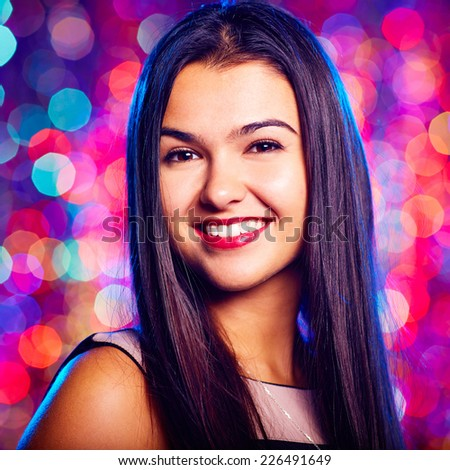 Portrait of cool girl with toothy smile enjoying party in nightclub - stock photo