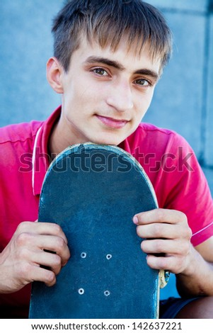Portrait of cool skateboard on the street - stock photo