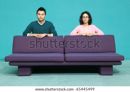 Portrait of couple behind couch