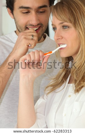 Portrait of couple brushing teeth