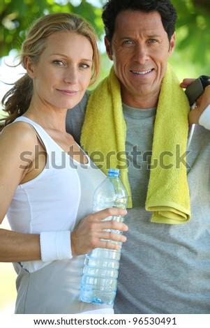Portrait of couple dressed in sportswear - stock photo