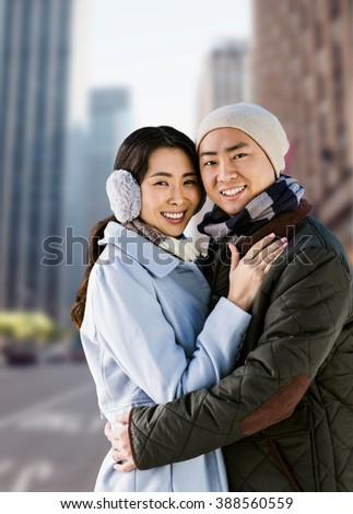 Portrait of couple embracing against new york street - stock photo