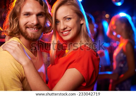Portrait of couple having good time at nightclub - stock photo
