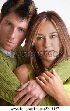 Portrait of couple hugging - stock photo
