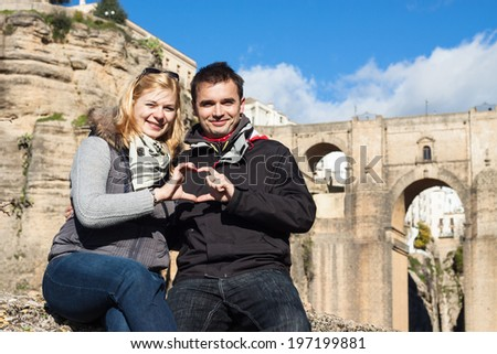 Portrait of couple in love enjoying sunny autumn day in Ronda, Andalusia, Spain. - stock photo