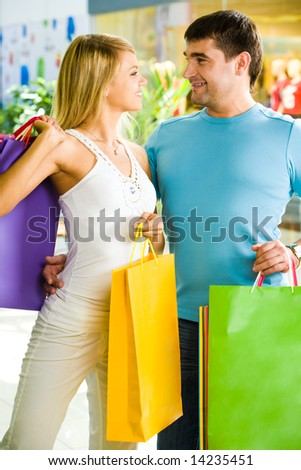 Portrait of couple looking at one another in the shopping centre