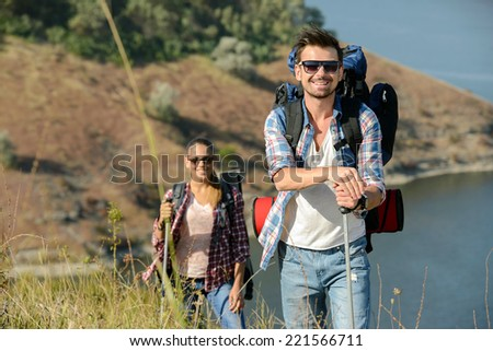 Portrait of couple of happy hikers in the countryside