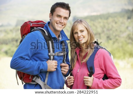 Portrait Of Couple On Hike In Beautiful Countryside - stock photo