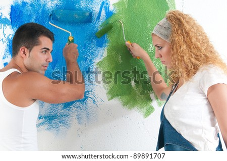 Portrait of couple painting at home - stock photo