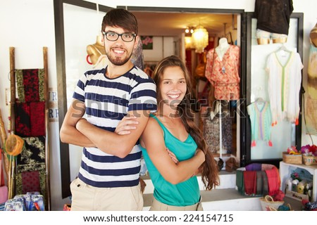 Portrait Of Couple Running Clothing Shop Together - stock photo