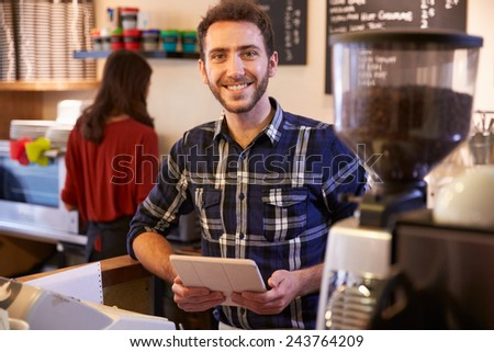 Portrait Of Couple Running Coffee Shop Together - stock photo