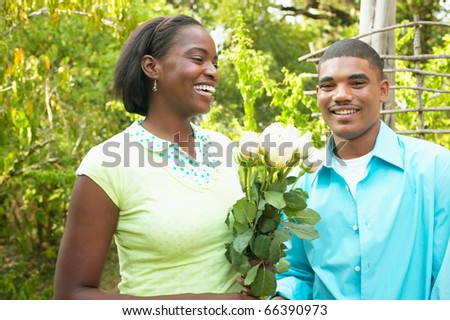 Portrait of couple with roses - stock photo