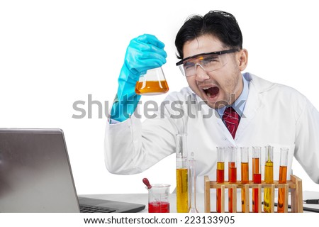 Portrait of crazy chemist doing research with chemical fluid - stock photo