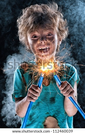 Portrait of crazy little electrician over black background - stock photo