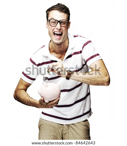portrait of crazy man saving money in piggy bank against a white background - stock photo