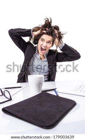 Portrait of crazy stressed young business woman screaming and pulling her hair over white background - stock photo
